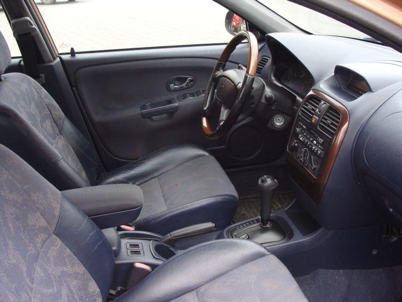 Przeglądasz: Mitsubishi Carisma 1.8 GDI 2000 r.